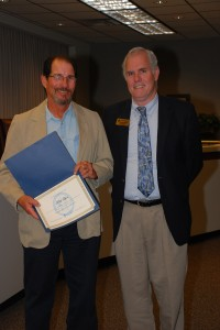 Ken Luce (left) was presented a certificate for his $250 honoraria for creatorship of an art exhibition painting titled El Papa in the El Paso Museum of Art.