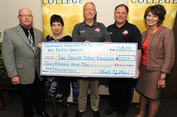The Southeast Volunteer Fire Department recently donated $2,000 to the San Jacinto College Foundation to start a scholarship fund for Emergency Medical Services students at San Jacinto College. People attending the check presentation include, from left, Board Chair Dan Mims, Board Member Marie Flickinger, Chuck Tylka, Southeast VFD Chief; Dean Baier, Southeast VFD firefighter and paramedic; and Chancellor Dr. Brenda Hellyer, who thanked Mr. Tylka and Mr. Baier for their support and welcomed the VFD's partnership with San Jacinto College.