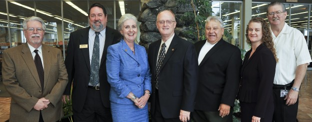 Dr. Barbara Hanson (third from left) was recently welcomed by Central campus administrators, from left: Dr. James Braswell, dean of administration; President Dr. Neil Matkin; Dr. Steve Horton, technical dean; Dr. Timothy Elliot, dean of evening and weekend college; Karen Blankenship, library director; and David Norman, automotive department chair.