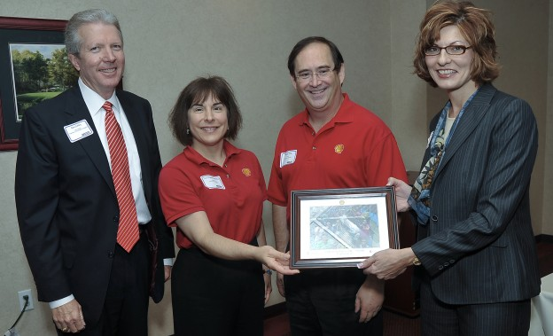 Don Coffey (left), Lee College Board of Regents Chair, and Dr. Brenda Hellyer, Chancellor, San Jacinto College (right), recognize Terri O'Reilley and Monte King of Shell for their support of EnergyVenture Camp.