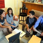 Hispanic American family at couch making emergency plan.