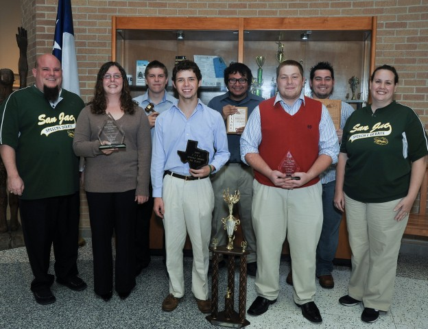The San Jacinto College North speech and debate team, displaying some of their many trophies, includes (from left) Floyd McConnell (faculty advisor), Amanda Alexander, Tyler Cashiola, Ian Jacoby, Jesus Villegas, Austin Cain, Jason Savoie, and Leigh-Anne Williams (faculty advisor).