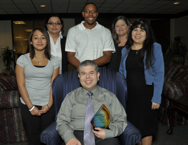 Standing, left to right: Selene Lopez, Research Clerk; Rosy Bynum, Senior Research Analyst; Leonard Simpson, Survey Research Analyst; Patti Walling, Office Manager; and Linda Perez, Information Management Liaison Business Analyst. Seated: George González, Jr., Director of Research & Institutional Effectiveness.