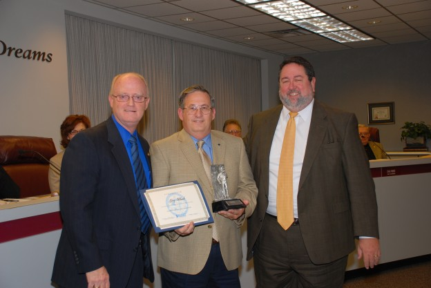 Greg Black (center) was presented a certificate and trophy by Dr. Steve Horton (left) and Dr. Neil Matkin (right) for his recognition as a GM World Class Technician.