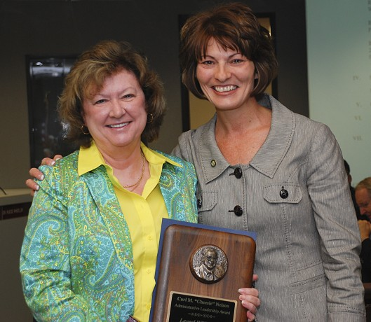 Dr. Brenda Hellyer congratulated Dr. Laurel Williamson at a recent Board of Trustees meeting.
