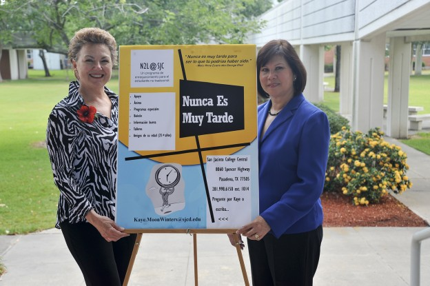 """Shown with a promotional poster are (from left) Kaye Moon Winters, founder of the """"Nunca es Muy Tarde"""" club, and Yolanda Capelo, who provides valuable assistance."""
