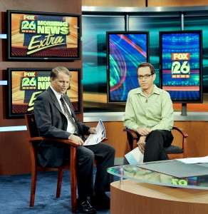 SBDC Director Richard Prets, left, chats with Fox TV News reporter Ruben Dominguez shortly before going on air.