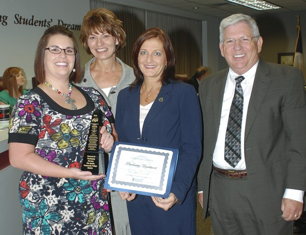 On hand for the presentation or the procurement award were, from left, Randi Faust, purchasing manager; San Jacinto College Chancellor Dr. Brenda Hellyer; Ann Kokx-Templet, contracts and purchasing services director; and Ken Lynn, vice chancellor of fiscal affairs.