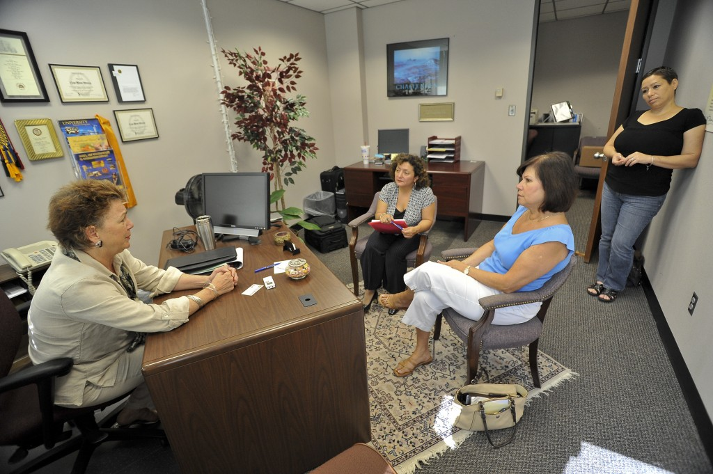 La Voz reporter Silvia Struthers (center) interviewed San Jacinto College employees Kaye Moon Winters, Yolanda Capelo, and Consuelo Lemur (left to right) for the newspaper article.