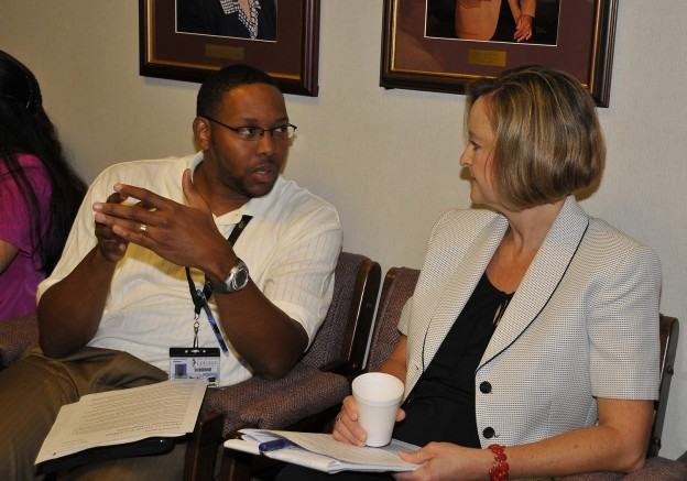Leonard Simpson, survey research analyst at San Jacinto College, and Cindy Ullrich, research analyst at Brazosport College, discuss the Institutional Information System during a break at the recent GCAIR meeting.