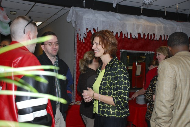 Dr. Brenda Hellyer greets employees at the District office holiday luncheon.